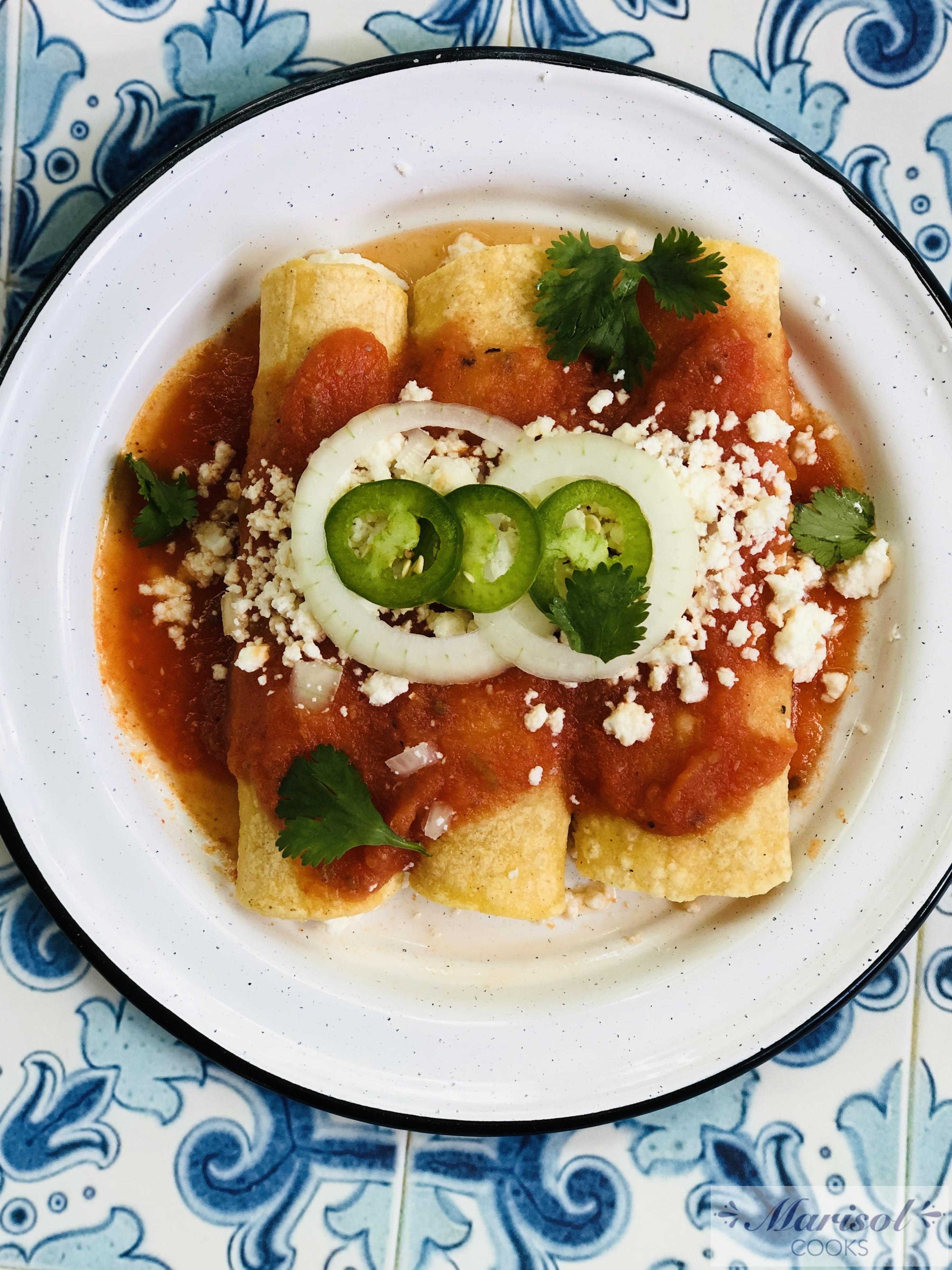 Entomatadas de Queso (Queso fresco Enchiladas in Tomato sauce)