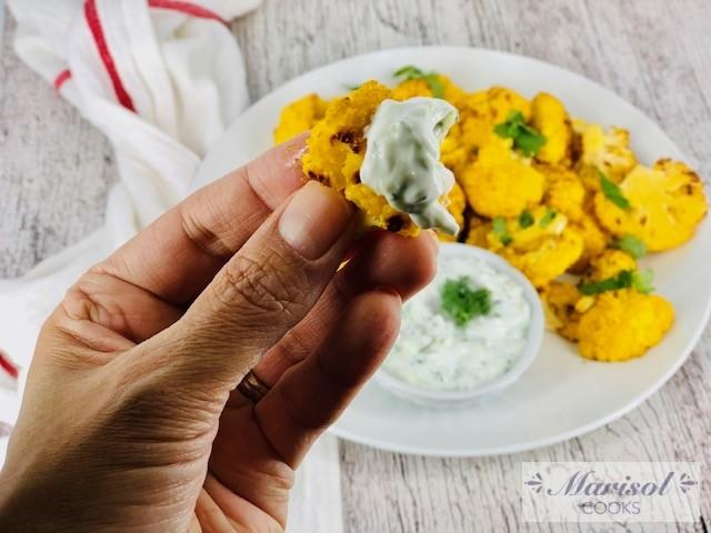 Roasted Yellow Cauliflower with Tzatziki Sauce.